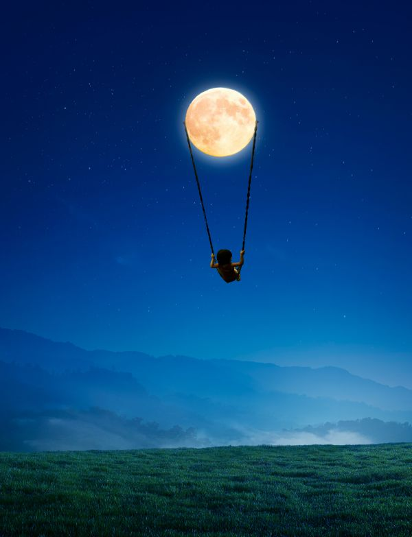 Little girl on a swing hangin from the moon