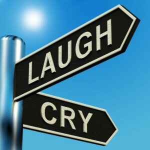 """Signpost reading """"Laugh"""" and """"Cry"""""""